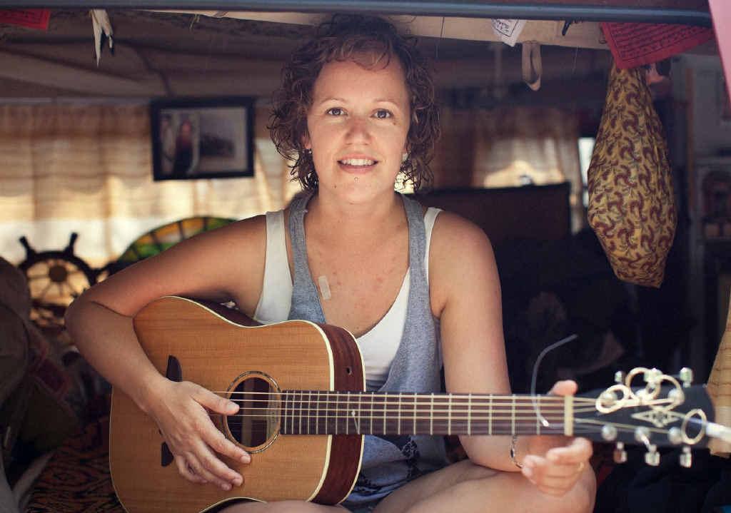 ON SONG: Neleke McDermott's friend Melissa Galea, playing her guitar before she became desperately ill.