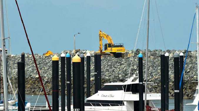 ON THE JOB: Repair work is under way on the Breakwater at Mackay Harbour.
