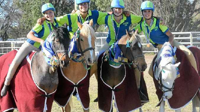 VICTORY SPOILS: Winners' grins are on the faces of the victorious Zone 21 Junior A team, Nikki Burraston, Leesa Eastwell, Emily Bradfield and Grace McLauchlan after winning in the Mounted Games competition.