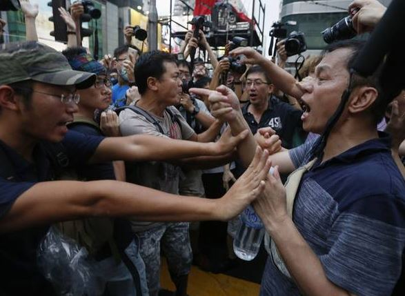 Allegations that the Chinese authorities have 'bussed in' gangs of organised agitators to provoke violence and delegitimise the pro-democracy campaign have been gaining credence