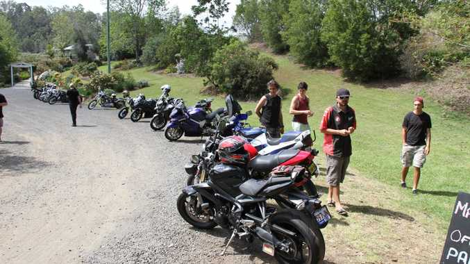 Enthusiasts admire the motorcycles in the marshalling area for the Lions TT at Ripples on the Creek.