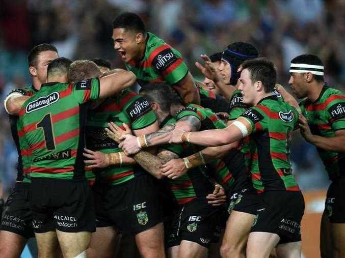 Rabbitohs' players celebrate a try from George Burgess during the 2014 NRL Grand Final match between the South Sydney Rabbitohs and the Canterbury-Bankstown Bulldogs at ANZ Stadium in Sydney, Sunday, Oct. 5, 2014.