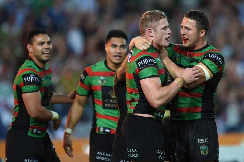 Rabbitohs' George Burgess (C) celebrates after scoring during the 2014 NRL Grand Final match between the South Sydney Rabbitohs and the Canterbury-Bankstown Bulldogs at ANZ Stadium in Sydney, Sunday, Oct. 5, 2014.