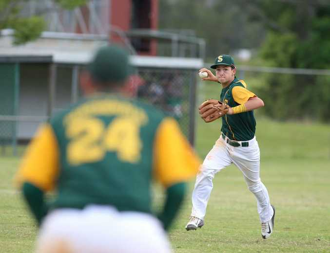 Gold Coast's Conor Laverty pitching it to Callum Macdonald on first base during the Under 16's Far North Coast v Brisbane South Queensland state titles game. October 4, 2014.