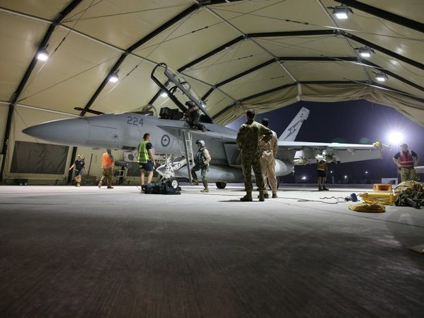 EYE IN THE SKY: RAAF aircrew disembark after completing their first mission over Iraq.