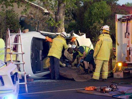Emergency services work to free a female trapped in a single vehicle crash at the intersection of Hume St and Hibiscus Dr, Kearneys Spring.