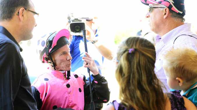 CENTRE OF ATTENTION: Jockey Jim Byrne reflects on his success riding Vaz De Torres to victory in yesterday's CFMEU Women's Auxillaries Class 4 race at Bundamba.