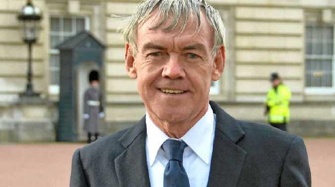 LIFE WORK: Sir Rod Beattie outside Buckingham Palace in December 2013 receiving his MBE.