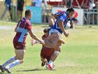 GAINING IMPORTANCE: Perth Southern Lions player Conan Alai attempts to break the tackle of the UQ Red Heavies defence in the Bowl final.