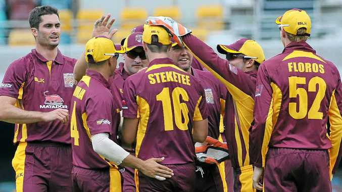 VICTORY: The Bulls celebrate Mark Steketee's catch during the Matador BBQs One Day Cup match between Queensland and Victoria at the Gabba on Saturday.
