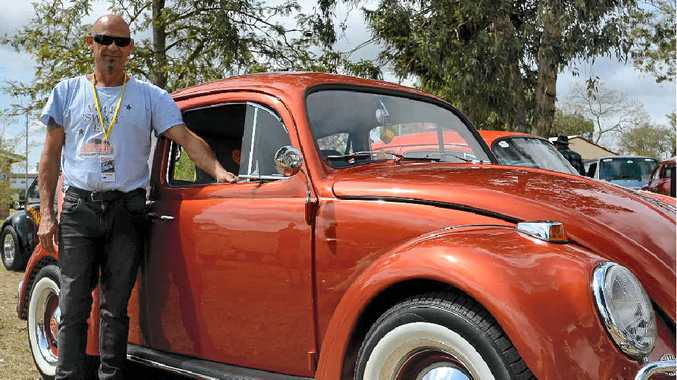 Ray Johnston from the Gold Coast with his 1966 VW Beetle Tangerine Dream, named after the Beatle's song, at the display in Leslie Park on Saturday.