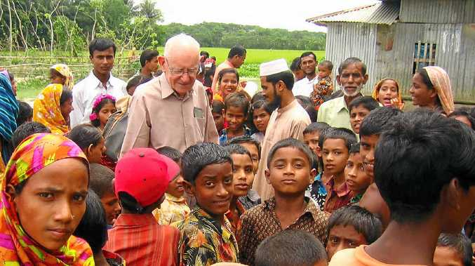 HUMBLE AND AWE-INSPIRING: After military service and a successful career in retailing, Fred Hyde was drawn to southern Asia, where he looked after an orphanage-farm run by an Australian aid agency before starting CO-ID. Fred is pictured here with families from a CO-ID school in Bangladesh.