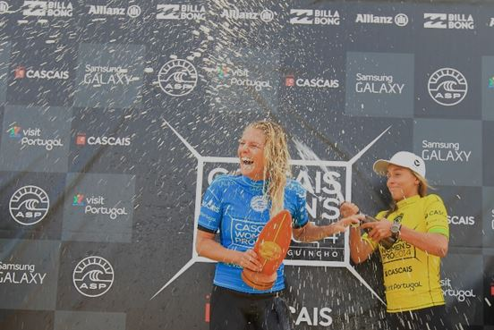 Stephanie Gilmore celebrates her win at the Cascais Women's Pro.