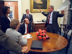 US President George W. Bush and his senior staff in the Oval Office, working on the speech he delivered on the night of the September 11 attacks, 2001.