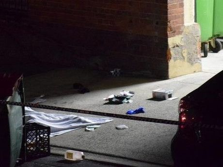 A man's body covered with a blanket at a home in Dath St, in Brisbane suburb of Teneriffe.