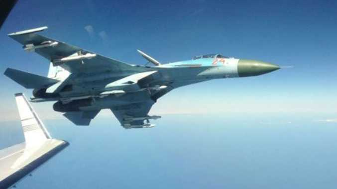 The Russian su-27 fighter jet photographed next to a Swedish intelligence plane.
