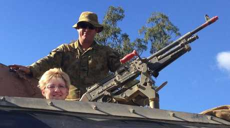 Member for Capricornia Michelle Landry behind the gun of an Australian Bushmaster Light Armoured Vehicle at Shoalwater Bay.