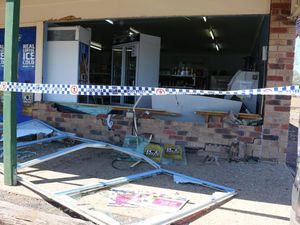 Burnt out ute used in ram raid