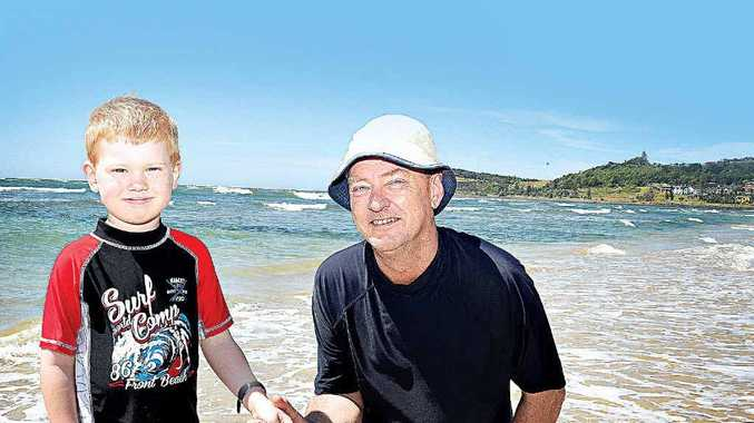 CLEAN BEACH: Nikolai Arnold, 6, with his granddad Kim Kjaer-Olser of Brisbane, enjoying the beautiful Seven Mile Beach, in Lennox Head.