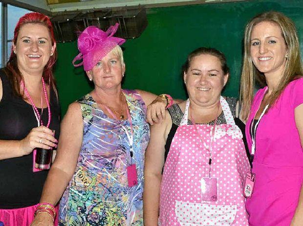 KITCHEN GALS: Co-ordinator Sheree Hyslop of Broadwater, Yvonne Sawtell of Goonellabah, Carmen McLennan of Broadwater and Tenille Leahy of Goonellabah celebrate Think Pink Broady.