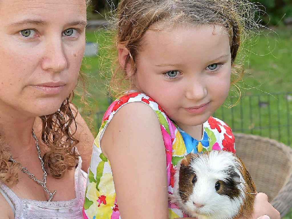 STOP MAULING: Rebekah Barber with her daughter Amelia Schultz, 5, is calling on the council to do something about a vicious rogue dog.