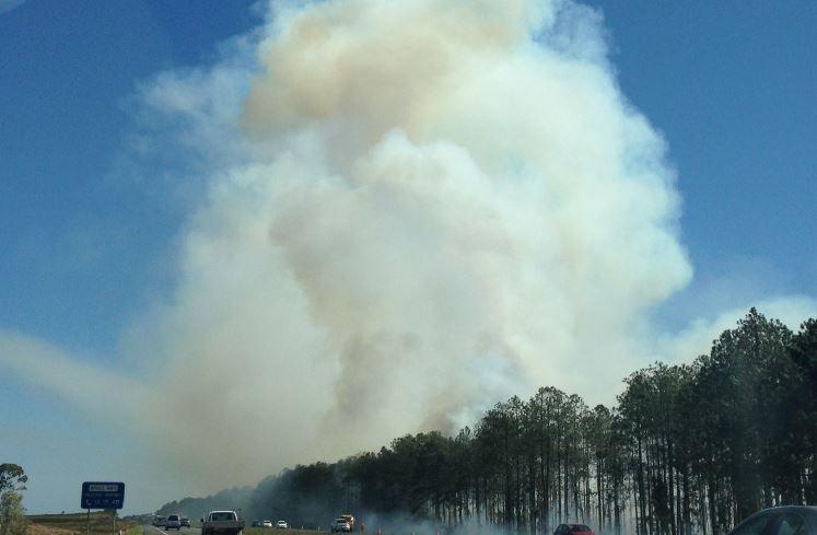 A bushfire is affecting highway traffic near Roys Rd.