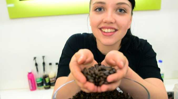 BEAN FACTS: Alowishus Delicious says the rise of coffee bean prices will not necesarily mean a rise in price of a cup of coffee. Pictured here is staff member Amy Baldwin. Photo taken on Wednesday, 8 October 2014. Photo: Max Fleet / NewsMail