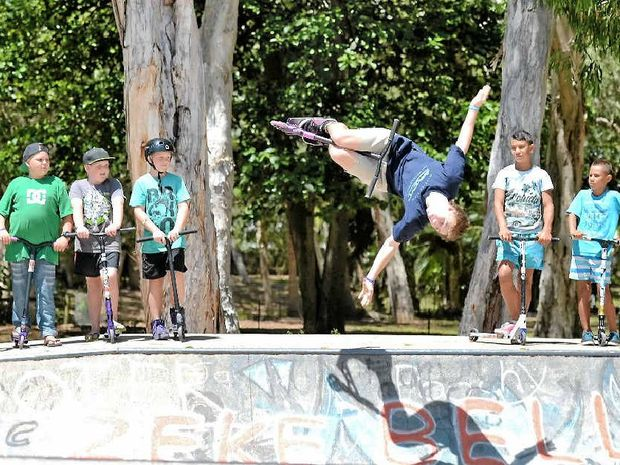 Darcy Cherry-Evans shows his skills at the Slade Point Skate Park as Judd Mooney, Jaxon Mooney, Cody Atherton, Luke Turner, Tyrell Lafituanai, Kaelen Lafituanai and Destin Lafituanai watch on.