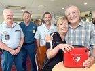 Paramedics (from left) Phil Switzer, Warren Pickering and Grant Schirmer took Burrum Heads Bowls Club chairman Martin Brindley (right) to hospital after duty manager Wendy Fifield used a defibrillator to save his life.