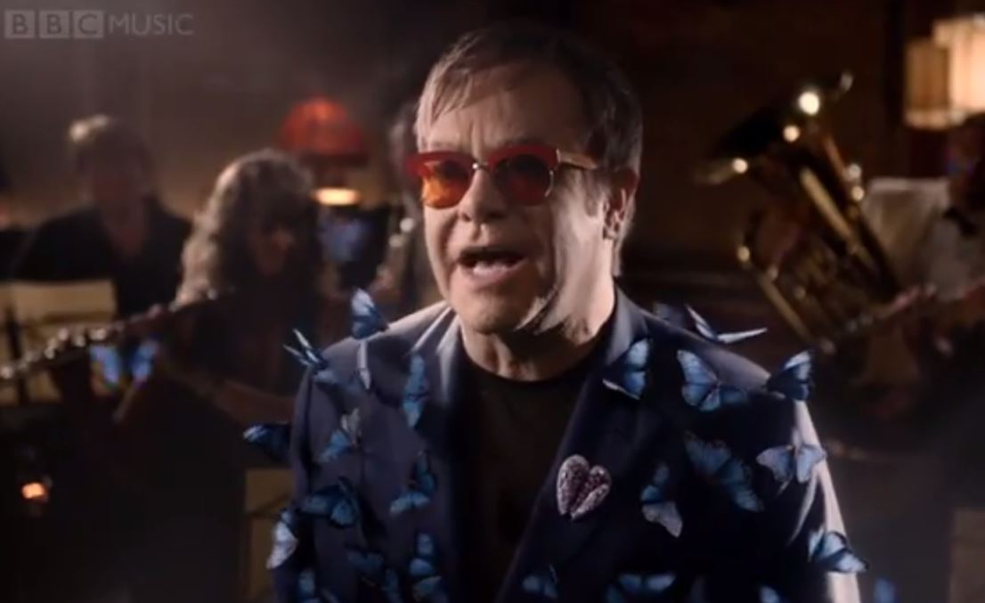 Elton John looking splendid in his butterfly-blue suit.