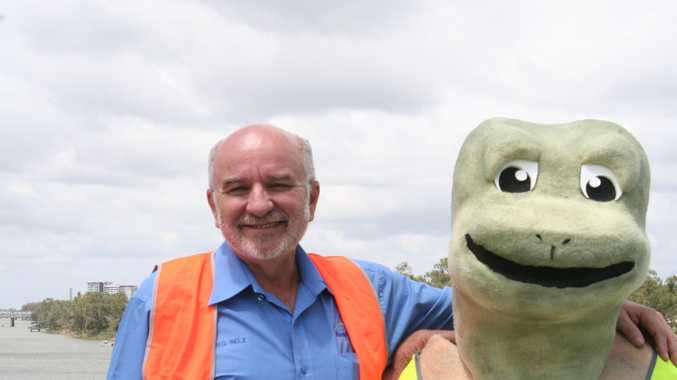 Councillor Greg Belz with the Fitzroy River Water mascot Fitz the turtle standing on the Rockhampton Barrage on Thursday, October 9 2014. Photo Madeline McDonald / The Morning Bulletin