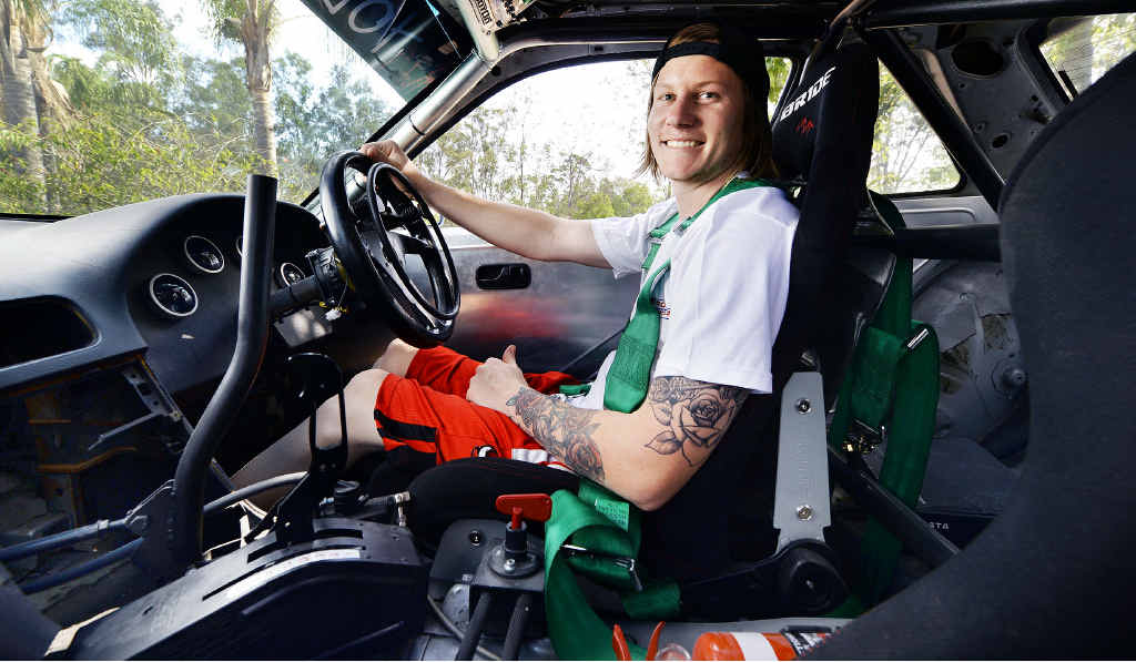 AT THE WHEEL: Tyson Litfin became a paraplegic after an accident in 2012 but can now race again after building a specially modified car.