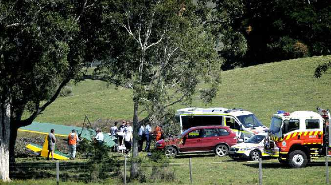 AT THE SCENE: Emergency services respond to the ultra-light plane crash near Knockrow, off Martins Ln, involving Ian Byrne.
