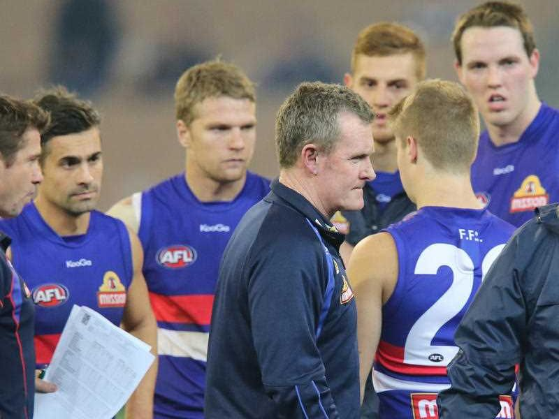 Bulldogs coach Brendan McCarthy talks to his players in the break during the Round 14 AFL match between the Melbourne Demons and the Western Bulldogs at the MCG in Melbourne, Saturday, June 29, 2013.