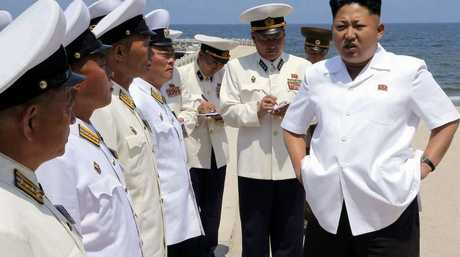 Kim Jong-un speaks to navy commanders ahead of a swimming drill in North Korea