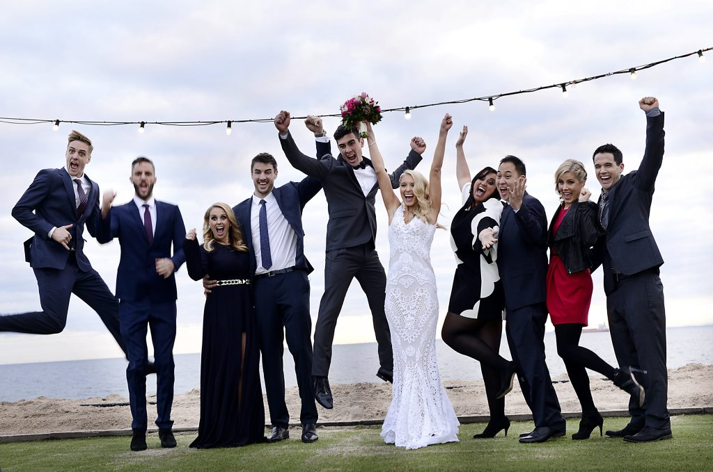 Max and Karstan, centre, pictured during their wedding on The Block Glasshouse. Also pictured, from left, Simon and Shannon, Dee and Darren, Chris and Jenna and Michael and Carlene.