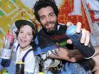 ART MATES: Jamie Kennedy-Beaumont, 7, and street artist Jeremy Austin in Larkin Lane, Lismore.
