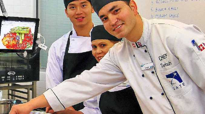 DISHING UP: Tien Si Nguyen, Editha Stone and Santosh Khadka, from Nepal, who has been learning training techniques.