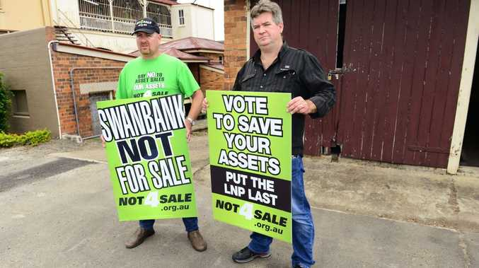 SAVE OUR KIDS: ETU organiser Stuart Traill and state secretary Peter Simpson warn apprentices will suffer under the LNP's leasing plans.