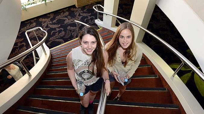 Richmond River High School students Tessa Nicolaou and Gina Park-Caesar finish their first HSC exam at the Lismore Workers Club.