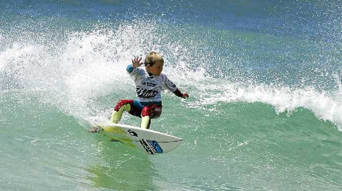 Jack O'Brien, from Skennars Head, makes the most of small surf at the Wahu Surfer Groms Comp at Coffs Harbour.