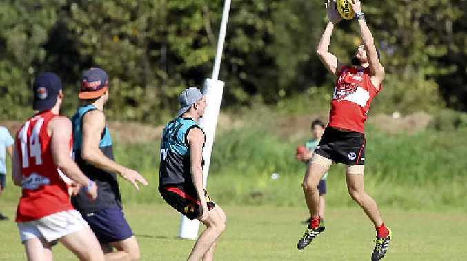 Redland's Darren Pfeiffer making a mark during the Redland Bombers v Lismore Swans 9s AFL match in Byron.