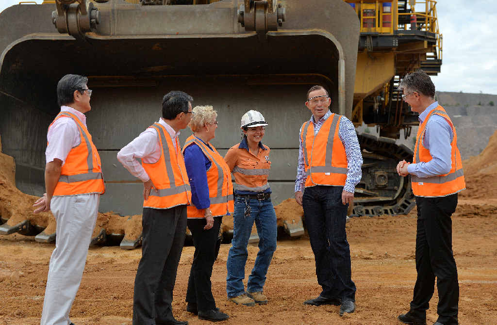 Mitsubishi Corporations' senior executive vice president Jun Kinukawa and president Ken Kobayashi, Federal Member for Capricornia Michelle Landry, mine worker Sarah Engel, Prime Minister Tony Abbott and BHP Billiton Coal president Dean Dalla Valle at Caval Ridge.