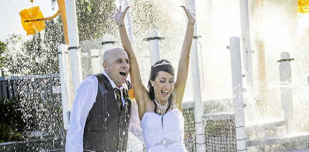 COOL MOVE: Newly-Webs Andrew and Melony Cole tied the knot in a wet and wild wedding on Friday.
