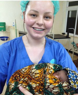 UNFORGETTABLE: Kelsey Milner-Cherry nurses a new born baby she witnessed being born in Tanzania, Africa. INSET: Kelsey with a child from an orphanage.