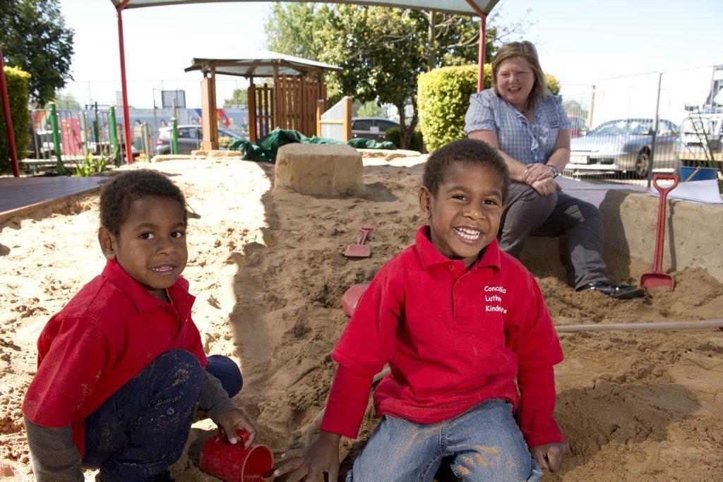 Image for sale: Tomas (left) and Riley Mason with their Concordia Lutheran Kindergarten teacher Megan McIvor.