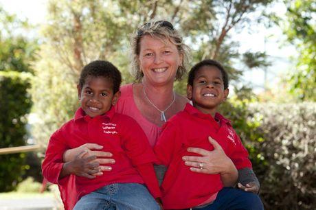 Riley (left) and Tomas Mason of Concordia Lutheran Kindergarten with mum Debbie Mason.
