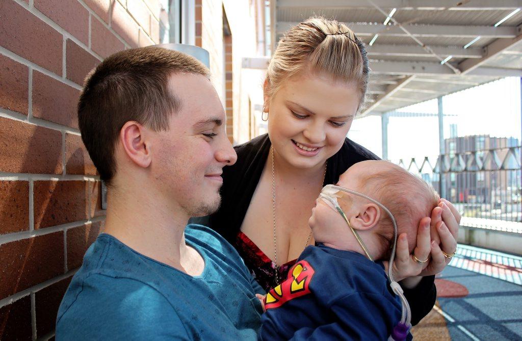 Taleah and Joel Blayney hold their son Kurt.