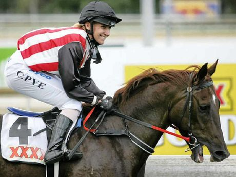 TRUE PROFESSIONAL: Jockey Carly-Mae Pye, pictured on Sporting Page after winning a race at Callaghan Park in 2012, was last night fighting for her life in the Rockhampton Hospital.