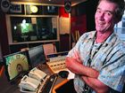 VOICE OF THE COAST: Much-loved ABC broadcaster John Stokes in the studio.